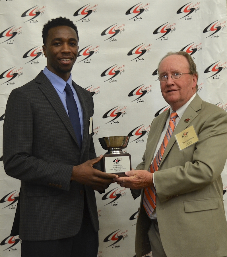 Donald Hicks Receiving Award for Boys Basketball Outstanding Athlete from Steve Johnson